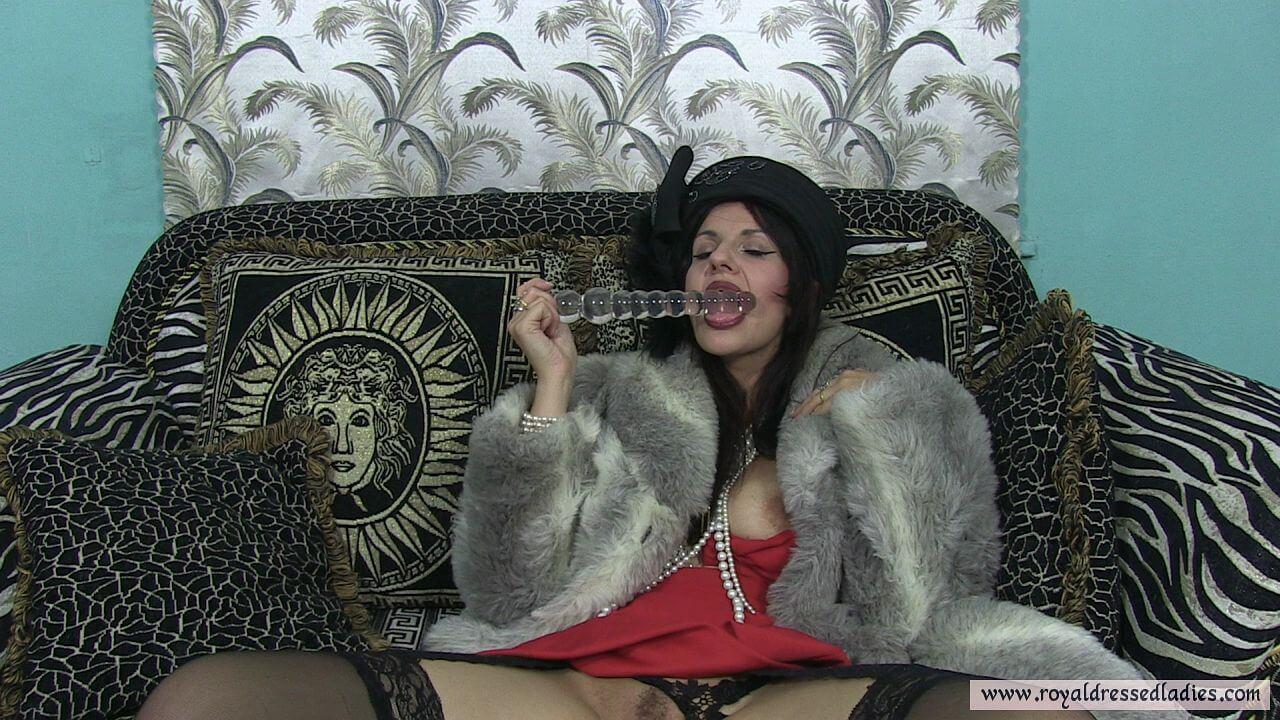 Fur slut fucks herself with a big Glass Dildo